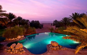 A photograph of one of the private pools at sunset guest can enjoy at Al Maha Dubai.