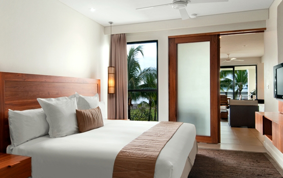 bedroom-of-a-guestroom-at-hilton-hotel-and-sp