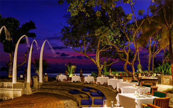 Sunset view of an outside restaurant serving buffet at the Oberoi Resort and Spa, Seminyak, Bali