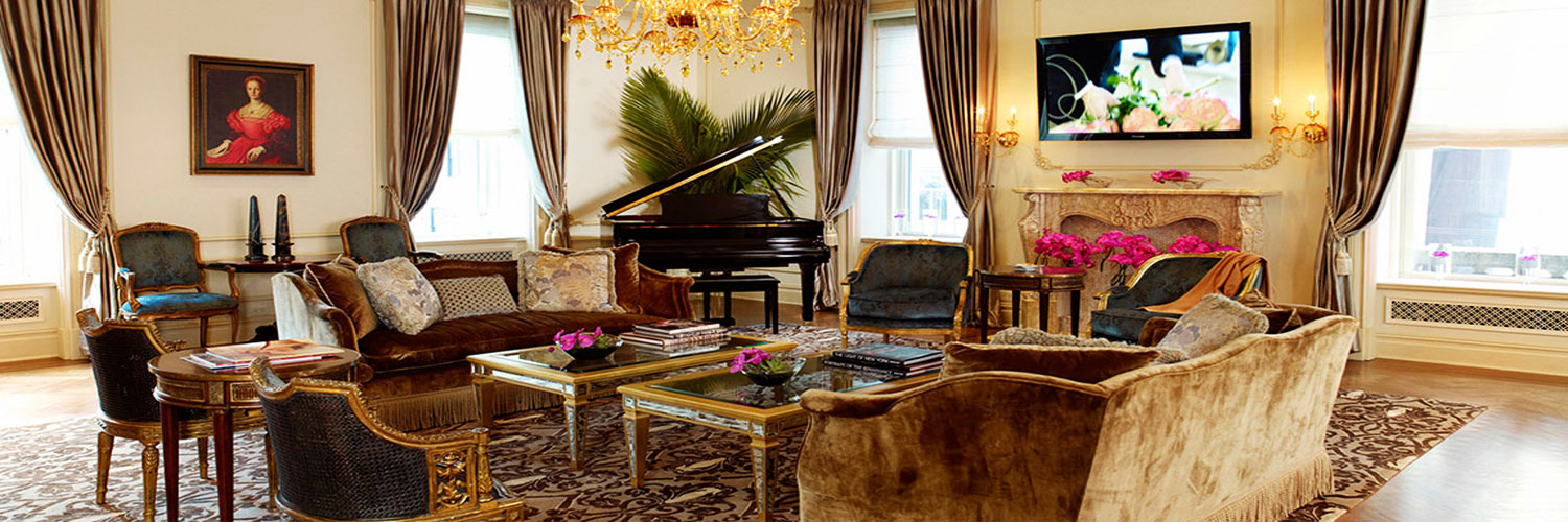 A photograph showcasing the living room area of the Royal Plaza One of a Kind Suite at The Plaza Hotel New York, USA