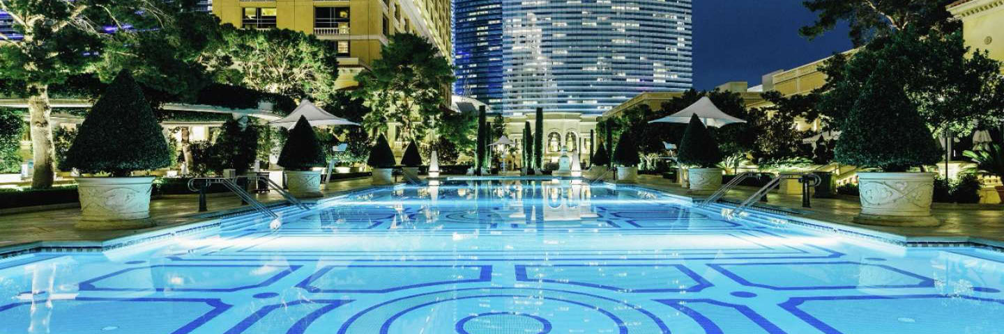 A photograph of the magnificent pool and view at night time, at Bellagio, Vegas.